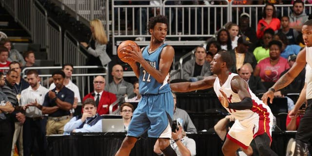 Andrew Wiggins of the Minnesota Timberwolves handles the ball against the Miami Heat.