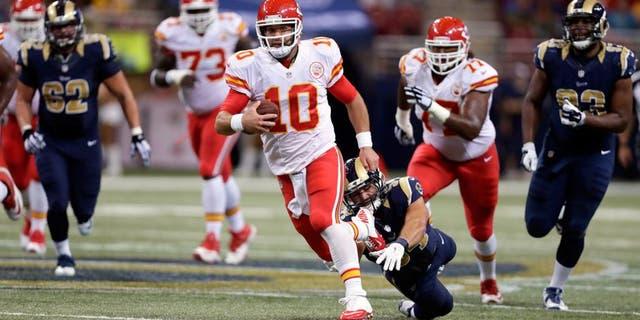 Kansas City Chiefs quarterback Chase Daniel scrambles for a 14-yard gain during the second quarter of an NFL preseason football game against the St. Louis Rams Thursday, Sept. 3, 2015, in St. Louis. (AP Photo/Tom Gannam)