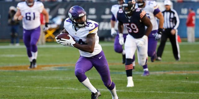Minnesota Vikings wide receiver Stefon Diggs runs to the end zone for a touchdown during the second half of an NFL football game against the Chicago Bears on Sunday, Nov. 1, 2015, in Chicago.