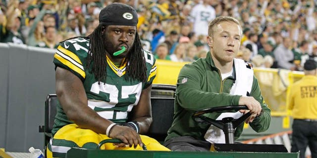 Green Bay Packers running back Eddie Lacy is carted off the field after being injured during an NFL football game against the Seattle Seahawks, Sunday, Sept. 20, 2015 at Lambeau Field in Green Bay, Wis.
