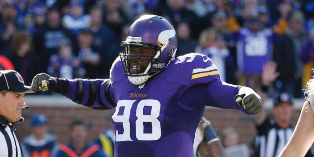 Minnesota Vikings defensive tackle Linval Joseph reacts after a play during the first half of an NFL football game against the St. Louis Rams on Sunday, Nov. 8, 2015, in Minneapolis.