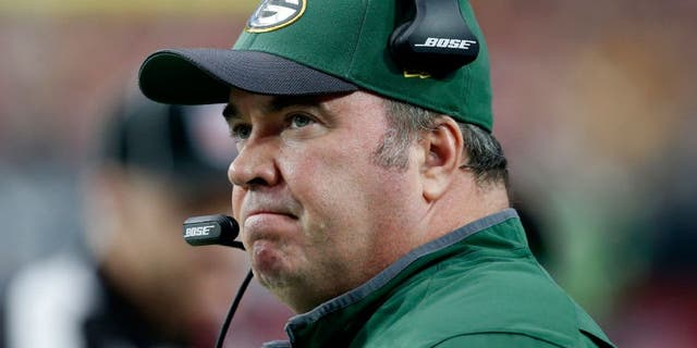 In this Dec. 27, 2015, file photo, Green Bay Packers head coach Mike McCarthy watches his team against the Arizona Cardinals in Glendale, Ariz.