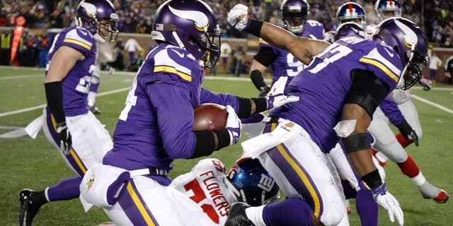 Minnesota Vikings cornerback Captain Munnerlyn runs with his interception of a pass from New York Giants quarterback Eli Manning during the second half Sunday, Dec. 27, 2015, in Minneapolis.