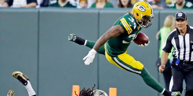 Green Bay Packers' Rajion Neal runs back a kickoff during the first half of an NFL preseason football game against the New Orleans Saints Thursday, Sept. 3, 2015, in Green Bay, Wis. (AP Photo/Jeffrey Phelps)