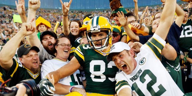 Green Bay Packers' Jeff Janis celebrates his touchdown catch with fans during the first half of an NFL preseason football game against the New Orleans Saints Thursday, Sept. 3, 2015, in Green Bay, Wis. (AP Photo/Mike Roemer)