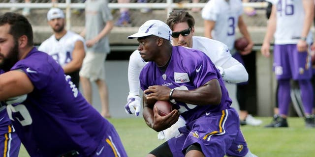Sunday, July 26: Minnesota Vikings running back Adrian Peterson carries the ball during practice training camp on the campus of Minnesota State University in Mankato.