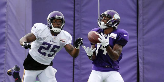 Tuesday, July 28: Minnesota Vikings wide receiver Stefon Diggs (right) catches a pass as cornerback Jabari Price defends during the first practice in full pads at training camp on the campus of Minnesota State University in Mankato.
