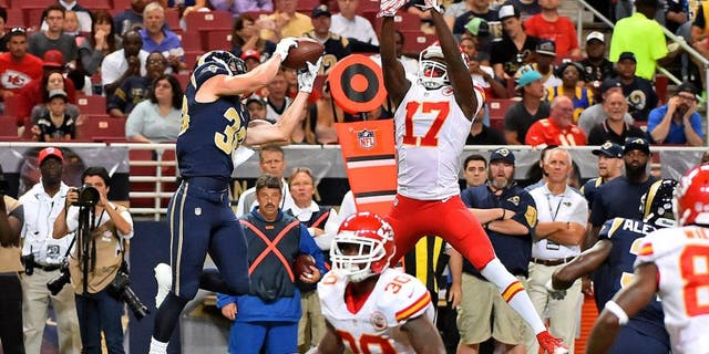 Sep 3, 2015; St. Louis, MO, USA; St. Louis Rams defensive back Cody Davis (38) intercepts a pass thrown by Kansas City Chiefs quarterback Chase Daniel (not pictured) and runs the ball back for a touch down during the first half at the Edward Jones Dome. Mandatory Credit: Jasen Vinlove-USA TODAY Sports