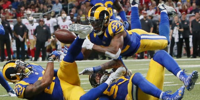 St. Louis Rams' Rodney McLeod, cornerback Trumaine Johnson (22) and linebacker James Laurinaitis converge on a pass but are unable to make an interception during an NFL football game against the San Francisco 49ers Sunday, Nov. 1, 2015, in St. Louis. (Chris Lee/St. Louis Post-Dispatch via AP) EDWARDSVILLE INTELLIGENCER OUT; THE ALTON TELEGRAPH OUT; MANDATORY CREDIT