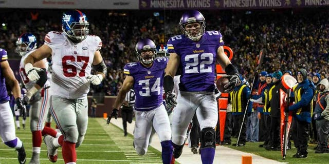 Minnesota Vikings safety Harrison Smith returns an interception for a touchdown during the second quarter against the New York Giants at TCF Bank Stadium in Minneapolis on Sunday, Dec. 27, 2015.