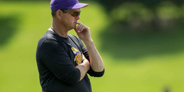 Jun 17, 2014; Eden Prairie, MN, USA; Minnesota Vikings head coach Mike Zimmer watches practice at Winter Park.