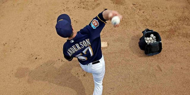 Milwaukee Brewers' Chase Anderson warms up before a inning of a spring training baseball game against the Chicago Cubs Thursday, March 3, 2016, in Phoenix. (AP Photo/Morry Gash)