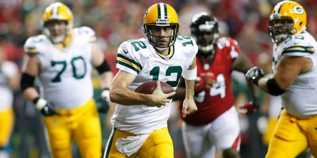 Oct 30, 2016; Atlanta, GA, USA; Green Bay Packers quarterback Aaron Rodgers (12) runs the ball against the Atlanta Falcons in the second quarter at the Georgia Dome. Mandatory Credit: Brett Davis-USA TODAY Sports