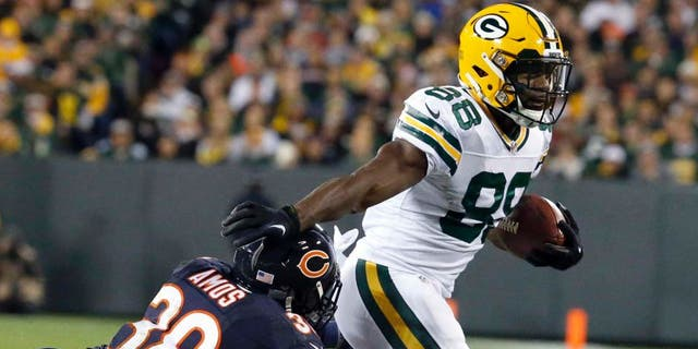Green Bay Packers wide receiver Ty Montgomery (88) pushes Chicago Bears free safety Adrian Amos (38) away as he carries the ball during the first half of an NFL football game, Thursday, Oct. 20, 2016, in Green Bay, Wis. (AP Photo/Mike Roemer)