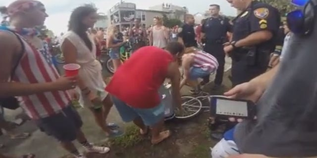Neptune Beach police officers approached Lane Pittman as he was packing up his guitar.