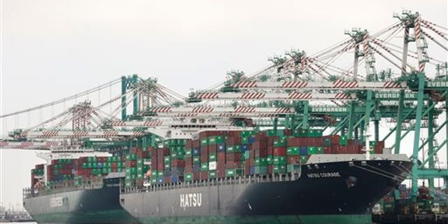 Cranes load containers onto the ships at the Port of Los Angeles, Tuesday, Feb. 17, 2015, in Los Angeles. (AP Photo/Jae C. Hong)