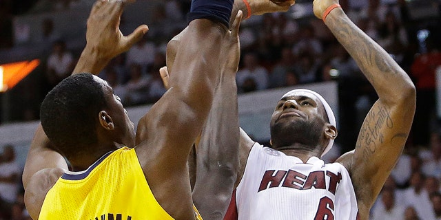 June 3, 2013: Miami Heat small forward LeBron James (6) shoots against Indiana Pacers center Ian Mahinmi (28) during the second half of Game 7 in their NBA basketball Eastern Conference finals playoff series.