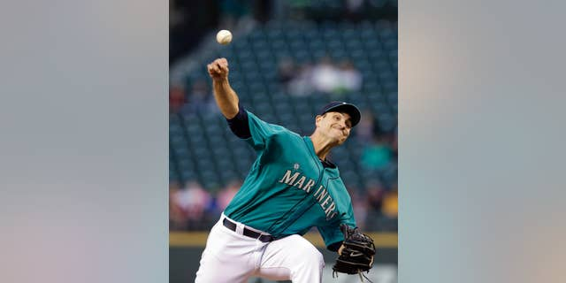 Seattle Mariners starting pitcher Chris Young throws against the San Diego Padres in the fifth inning in a baseball game Monday, June 16, 2014, in Seattle. (AP Photo/Elaine Thompson)