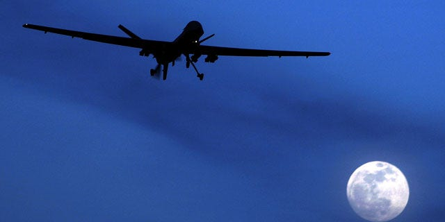 FILE - In this Jan. 31, 2010 file photo, an unmanned U.S. Predator drone flies over Kandahar Air Field, southern Afghanistan, on a moon-lit night. (AP Photo)