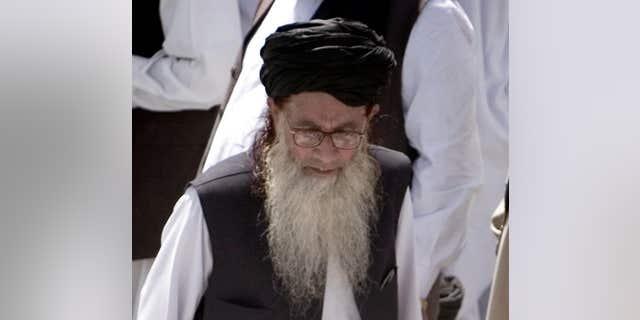 FILE 2009:  Pakistan's hard line cleric Sufi Muhammad arrives to address his supporters in Mingora, Pakistan.