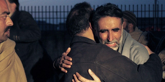 Jan. 1, 2013: A father of an aid worker, who was killed by gunmen, mourns the death of his daughter at a hospital in Swabi, Pakistan.