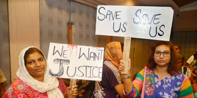 July 26, 2015: Pakistani Christian refugees protest UNHCR delays at a church in Thailand.