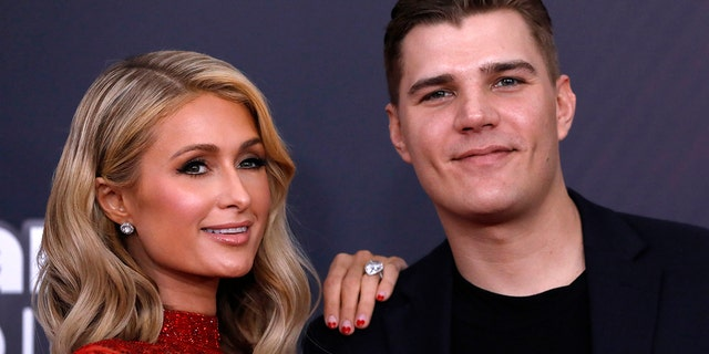 "Paris Hilton with fiance, ""Leftovers"" actor, Chris Zylka."