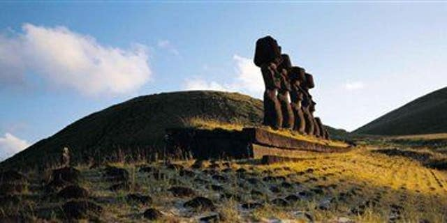 This undated photo released by Explora en Rapa Nui shows some of the massive Moai statues on Easter Island.