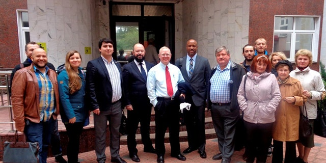 Ossewaarde, seen here with his legal team and other supporters, was due back in a Russian court on Friday.