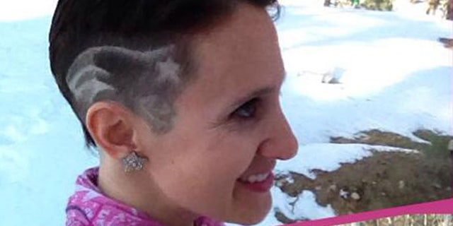 Paula McDonald, who is fighting breast cancer, said she hopes her move to have the Patriots logo shaved on the side of her head helps her team and raises awareness to perform self-examinations.