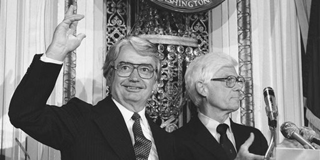FILE- In this Aug. 25, 1980 file photo, Wisconsin Gov. Patrick J. Lucey, left, waves to the audience at the National Press Club in Washington after Independent presidential candidate John B. Anderson of Illinois, right, announced Lucey would be his vice presidential running mate. Lucey, a hard-nosed Democratic politician who later became ambassador to Mexico, died Saturday, May 10, 2014. He was 96. (AP Photo/File)