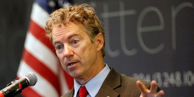 FILE - In this March 20, 2015, file photo, Sen., Rand Paul, R-Ky. speaks in Manchester, N.H. Ready to enter the Republican chase for the partys presidential nomination this week, the first-term Kentucky senator has designs on changing how Republicans go about getting elected to the White House and how they govern once there. Paul will do so with an approach to politics that is often downbeat and usually dour, which just might work in a nation deeply frustrated with Washington. (AP Photo/Jim Cole, File)