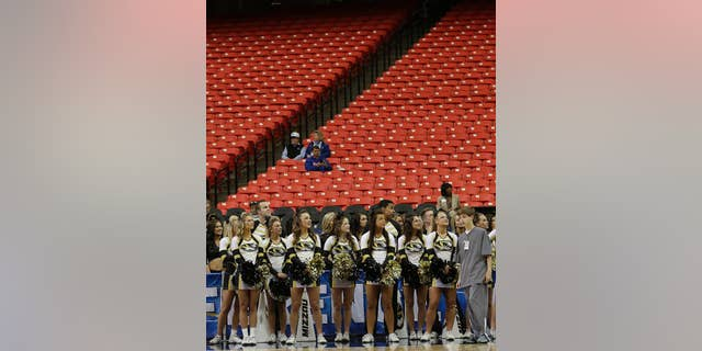 Missouri cheerleaders watch the floor during the first half of an NCAA college basketball game against Florida in the quarterfinal round of the Southeastern Conference men's tournament, Friday, March 14, 2014, in Atlanta. With rivalries in tatters, league alignments all messed up, and tens of thousands of empty seats, it might be time to reassess the need for conference tournaments. (AP Photo/Steve Helber)