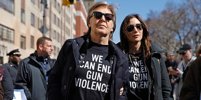 "Former Beatle Sir Paul McCartney joins the rally during a ""March For Our Lives"" demonstration demanding gun control in New York City, U.S. March 24, 2018. REUTERS/Shannon Stapleton - HP1EE3O173GC0"