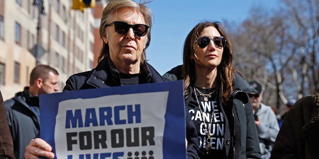"""Former Beatle Sir Paul McCartney joins the rally during a """"March For Our Lives"""" demonstration demanding gun control in New York City. March 24, 2018."""