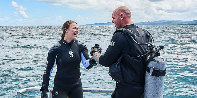 "Ronda Rousey with her shark diving trainer Paul de Gelder. ""Ronda Rousey Uncaged"" will kick off Discovery's annual Shark Week."