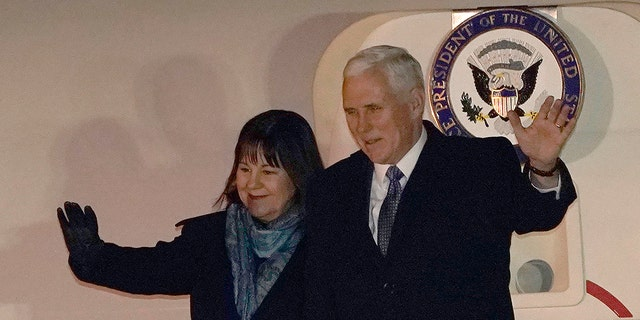 U.S. Vice President Mike Pence and his wife Karen wave upon arriving at Yokota Air Base on the outskirts of Tokyo, Tuesday, Feb. 6, 2018.