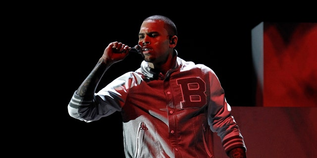 Feb. 12, 2012: File photo: Chris Brown performs during the 54th annual Grammy Awards, in Los Angeles. A judge in Los Angeles ordered a further review of Brown's community service on Monday, Sept. 24, 2012.