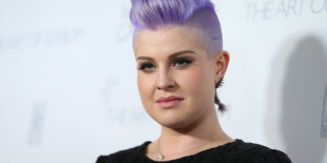 """FILE - In this Jan. 10, 2015 file photo, Kelly Osbourne arrives at The Art of Elysium Heaven Gala at Hangar 8 in Santa Monica, Calif. Osbourne apologized Tuesday, Aug. 4, 2015, for comments she made earlier in the day on """"The View"""" about Latinos  cleaning Donald Trump's toilets. (Photo by Omar Vega/Invision/AP, File)"""