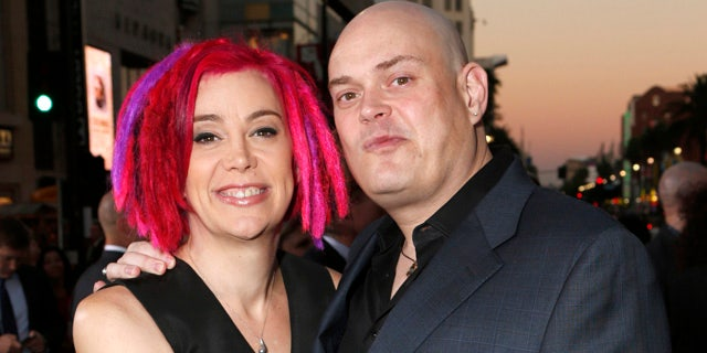 FILE - In this Oct. 24, 2012, file photo, co-directors Lana Wachowski and Andy Wachowski pose for a photo at the Los Angeles premiere of 'Cloud Atlas'. (Photo by Todd Williamson/Invision, File)