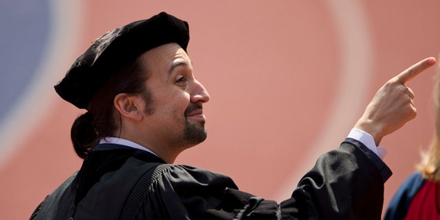 """Lin-Manuel Miranda, creator of the Broadway musical """"Hamilton,"""" pointsn during the University of Pennsylvania commencement ceremony, Monday, May 16, 2016, in Philadelphia. Miranda will speak at the ceremony and receive an honorary degree.   (AP Photo/Matt Rourke)"""