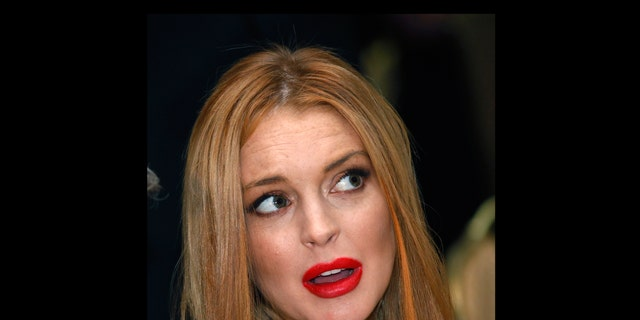 April 28, 2012: File photo, Lindsay Lohan attends the White House Correspondents' Association Dinner in Washington.