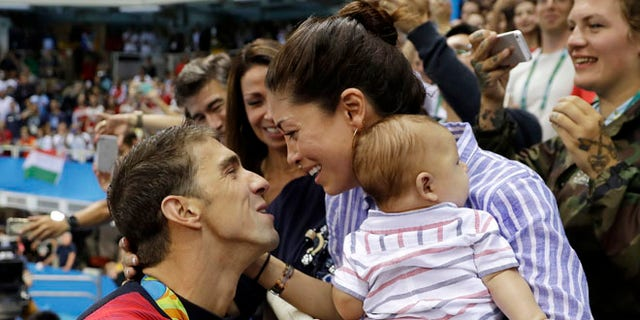Michael Phelps, fiance Nicole Johnson and baby Boomer during the swimming competitions at the 2016 Summer Olympics.