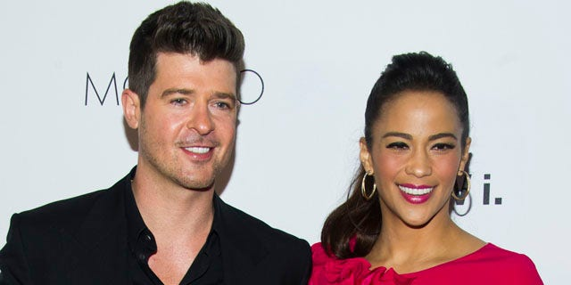 FILE - In this Wednesday, Oct. 23, 2013 file photo, Robin Thicke and Paula Patton attend the sixth annual GQ Gentlemen's Ball in New York. Patton has filed for divorce from Thicke and is asking for joint custody of their son. (Photo by Charles Sykes/Invision/AP, file)