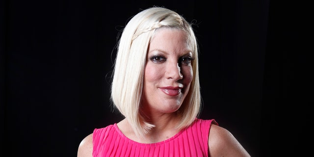 April 3, 2012: In this file photo, actress Tori Spelling poses for a portrait in New York. Spelling has given birth to her fourth child, a son named Finn.