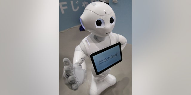 SoftBank's human-like robot named 'pepper' is displayed at its branch in Tokyo June 6, 2014.