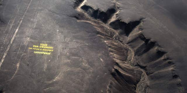 """In December 2014, Greenpeace activists set up large letters beside one of the designs that read: """"Time for Change! The future is renewable."""""""