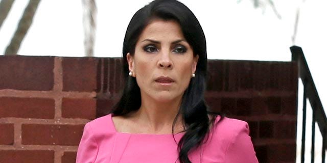 FILE - In this Nov. 13, 2012, file photo, Jill Kelley leaves her home in Tampa, Fla. Nine journalists were issued subpoenas Tuesday as part of a lawsuit filed by Kelley and her husband over the Obama administration investigation that led to the resignation of CIA Director David Petraeus. (AP Photo/Chris O'Meara, File)