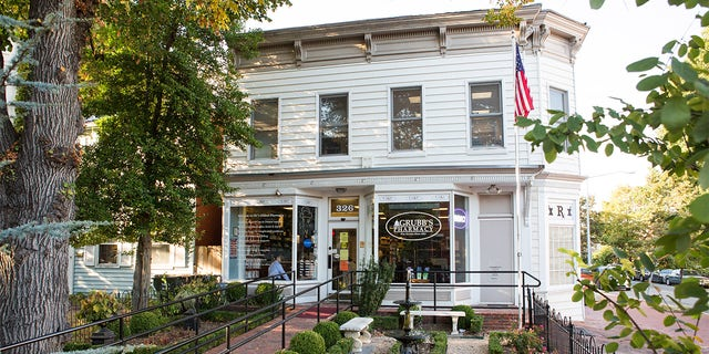 On October 6, 2017, the American Flag hangs outside of Grubb's Pharmacy in Northeast, Washington D.C. Grubb's Pharmacy, established in 1867 is the oldest pharmacy in D.C., and with its convenient location to The U.S. Capitol, services many Members of Congress.
