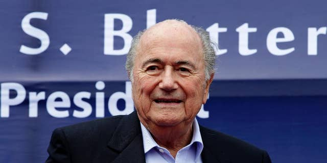 FIFA President Joseph S. Blatter prepares to address the crowd during the groundbreaking ceremony for a Football Artificial Turf under the FIFA Goal Project III in the country Sunday, Nov. 30, 2014 at Carmona township, Cavite province south of Manila, Philippines. The full size pitch will serve as the training facility and possible football stadium to boost football development in the Philippines. Blatter is here for the AFC (Asian Football Confederation) Player of the Year awards ceremony as well as the AFC's 60th anniversary. (AP Photo/Bullit Marquez)